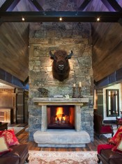 Anchoring the Montana Moss rock fireplace in the great room, the stately buffalo mount seems to represent the home itself: Massive and regal.