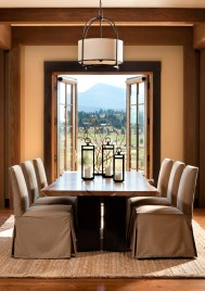 In the dining room, the designers took their color cues from the outdoor panoramic. The palette throughout is soft and subdued, a play of subtle hues.