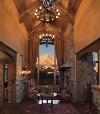 """The first element drawn in the house was the entryway window framing the mountain view. Even the timber beam reinforces the line to Lone Peak. The space was designed solely for the purpose of enjoying the majestic view, explained Smith. """"We didn't wan"""