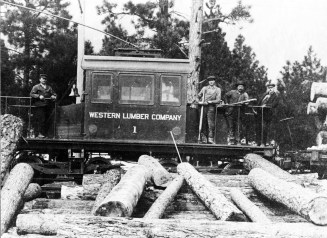 The Western Lumber Company dinkey hauled logs along the streetcar tracks to the landing upriver from the highway bridge, and on the west bank of the Blackfoot River. Photo from University of Montana Maureen and Mike Mansfield Library