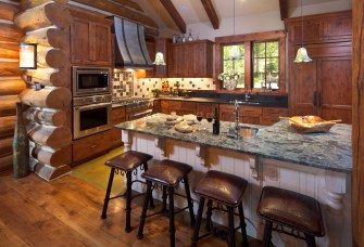 The kitchen includes a handmade zinc hood with hand-hammered steel strapping for the cooking area. The island is the centerpiece of the room with its Exotic River Blue countertop, one of the most extravagant in the world, it offers visual light displays a