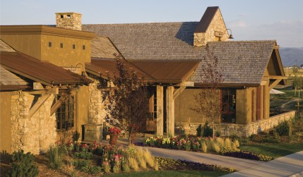 The Corral Clubhouse at Black Bull, designed by Locati Architects and built by RMR Group, incorporates timber and stone accents for an elegant but rustic appearance at this private golf course community in Bozeman. The building features locker rooms, a sh