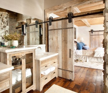 This bathroom's clean classic lines are beautifully accented with rustic simplicity; both the cabinetry and barn door are constructed from some of MRL's wide ranging stock of antique corral boards. Faure Halvorsen Architects and Highline Partners.