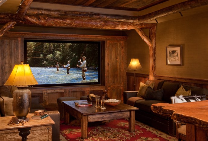 A customized theater room flanks the old saloon downstairs.