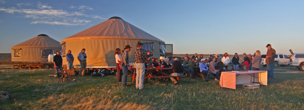 Families gather at the Yurt Camp on American Prairie Reserve. Photo by Dennis Lingohr