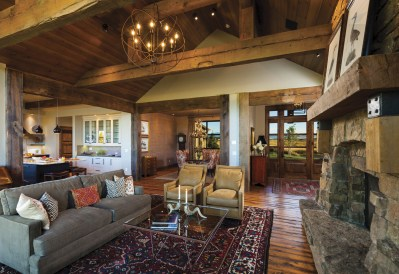 Visible from the front door, the living room is warm and inviting, with a large stone fireplace and storefront windows that offer vistas of the distant Spanish Peaks. Sue Hodapp was also easily able to incorporate furniture, such as the English breakfast