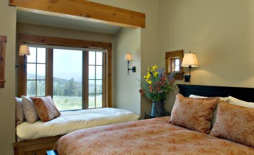 Window seating makes use of the gorgeous views and adds extra sleeping space for guests.