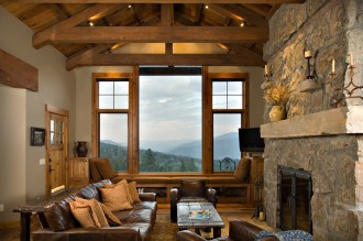 The great room, incorporates a two-sided natural stone fireplace (the other side faces the dining room) with plenty of room for family and friends to relax after a day on the slopes or a hike in the woods.