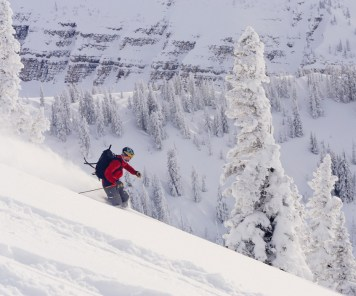 Slicing telemark turns through the fresh powder in the Idaho backcountry near the Baldy Knoll Yurt.