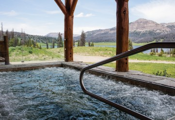 At Brooks Lake Lodge, a good soak leads to views of Pinnacle Buttes in the distance.