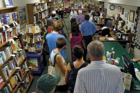 People gather in the narrow aisle of Missoula's Fact and Fiction bookstore to hear George McGovern say a few words about the release of his new book about Abraham Lincoln.