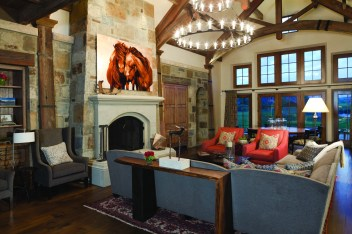 Chambers has a stable of artisans and furniture craftsmen she works with to make custom pieces to fit every room she does. A Robert Dutesco painting hangs over the mantel.