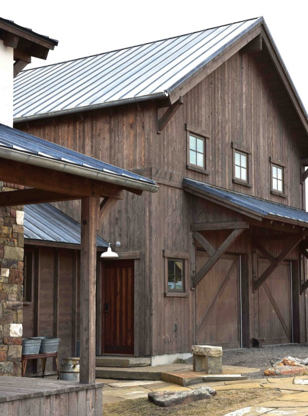 The Livingston home features a combination of rustic distressed wood, timberframe, stone and metal elements and is listed for $1.4. Inside, the home features select custom finishes, including a double-sided Tulikivi fireplace from Warmstone in Livingston.