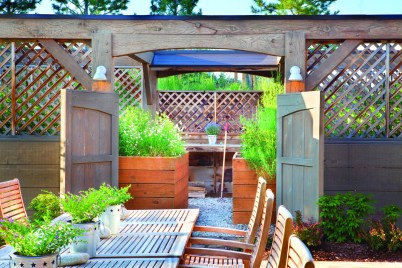 Outdoor seating and a raised-bed garden make this the perfect spot for summer relaxation.
