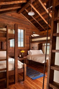 Yellowstone Traditions built custom bunk beds and ladders to loft areas to maximize sleeping space on this compound that can sleep 18 guests.