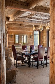 Interior designer Carole Young blended antiques, such as the 1960s ostrich egg chandelier in the dining room, with architecture inspired by Adirondack elements throughout the house.