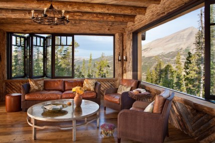 Putting a contemporary twist on the classic Adirondack screened-in porch, the Lone Peak porch features accordion windows that open to the majestic views of the surrounding mountains.