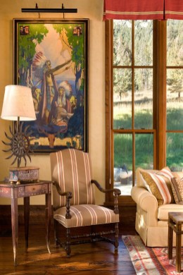1930s-era and contemporary paintings pepper the living and dining area. An historic painting by S.J. Bolanski anchors the collection.