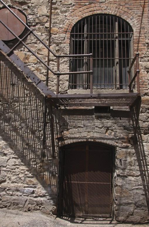 Gated doorways in an alley.