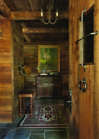 With classic artwork provided by Curtis Tierney, of Bozeman, the entry to the Moose Creek cabin is a statement of simple elegance.