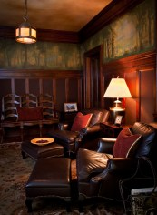 """Original handpainted English wallpaper from the 1920s balances the masculine tone of the """"cigar room."""" Langlas & Associates were able to restore the original oak flooring and Craftsman light fixtures designed by Fred Willson."""