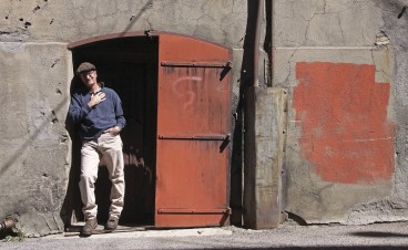 Jim Jarvis, Butte-Silver Bow's historic preservation officer, stands outside one of Butte's historic alley doors.
