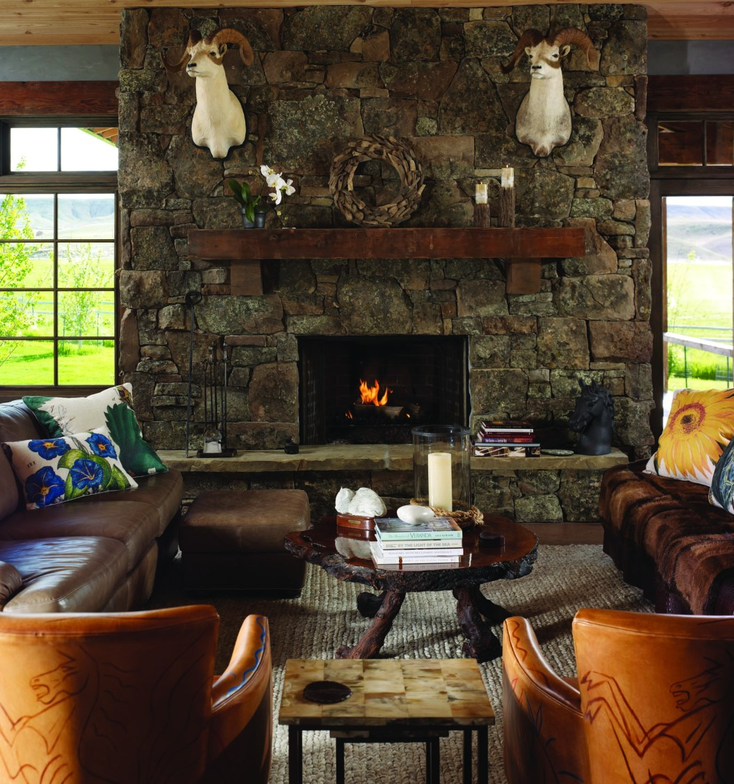 Open to both the great room and a spacious back porch, the double-sided fireplace is constructed of Montana moss rock.