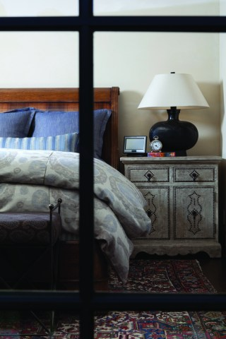 In the master bedroom a mixture of patterns is brought together by simple accents and complimentary colors.