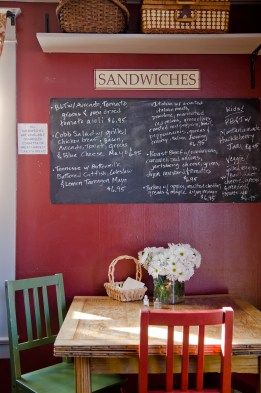 Chalkboards list the sandwiches, served on locally baked bread and the deli case displays an array of salads, from a sweet and tangy broccoli and grape salad to grilled vegetables.