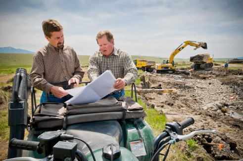Jeff Lazlo of Granger Ranches and Jon Jourdonnais of PPL MT, review Phase IV of O'Dell Project plans during construction in 2008. To date this private-public partnership has restored over eight miles of stream and about 600 acres of critical wetlands