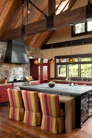 A poured concrete eating table in the kitchen matches the exterior bar in the outside room.
