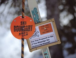 Signs warn skiers of the hazards ahead when they ski outside the Bridger Bowl boundary.