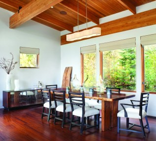 A custom walnut table fabricated by a local craftsman is the focal point in the dining room.