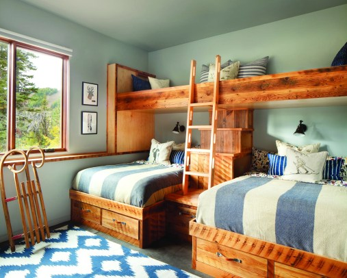 Custom bunk beds with built-in storage make the most of the guest room's modest footprint.
