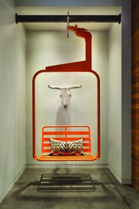 A revamped vintage ski lift chair provides fun and functional seating indoors.