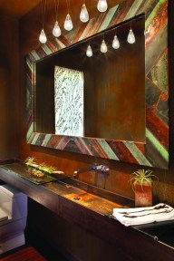 A steel beam sink and a rusted wall finish in the powder room turns the ordinary extraordinary.