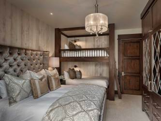 The guest suite features custom-built bunk beds as well as a king-size bed to maximize the private area of the home.