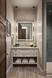 The sophisticated rustic theme carries over to the bathrooms where wood-inspired tile lines the floor and contemporary glass tiles enhance the walls.