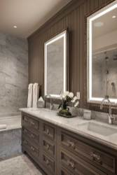 The master bathroom features Italian marble and a double vanity.