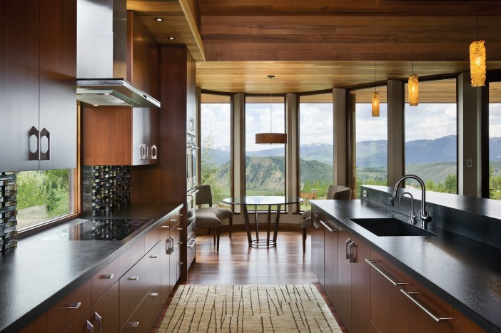 Inside, south-facing windows connect with views, while maximizing the solar gain to allow light into the main living space.