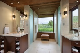 Dual showers in the master bathroom maximize luxury and dual vanities streamline the flow of the private space.