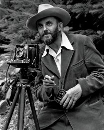 Ansel Adams in 1947, light meter in hand.