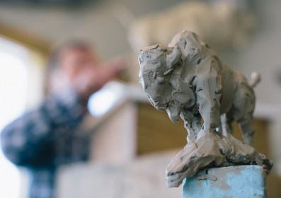 """Bozeman sculptor Ott Jones follows a """"maquette"""" as he works in his studio on a clay bison. Working professionally for the past 30 years, his sculptures have been acquired by the C.M. Russell Museum and the National Museum of Wildlife Art, and he has several monumental sculptures around the country."""