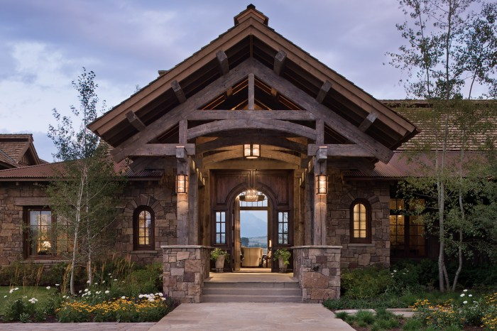 The gabled timberframe entry becomes the focal point for visitors as they enter the home, but once through the front door, the mountain vistas unfold.