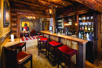 The Whalen's desire for a lodge-like feeling is accomplished through multiple gathering spaces, including a bar for après ski drinks right by the slopeside door.
