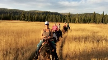 Five relatively inexperienced horsebackriding women are all smiles as they cross the Bechler Meadows. Photo by Corinne Garcia