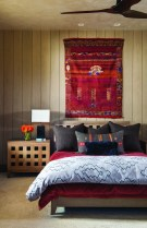 "In the bedroom, bright reds compliment the softer cream, gray and taupe tones. ""They wanted it to be comfortable and livable, to meet the Montana rustic aspects [of design] but also follow the clean and simple lines of contemporary interiors,"" Elizabeth Schultz, interior designer, said."