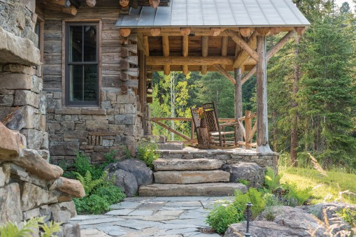A back porch makes the most of indoor outdoor living in the best rustic tradition.