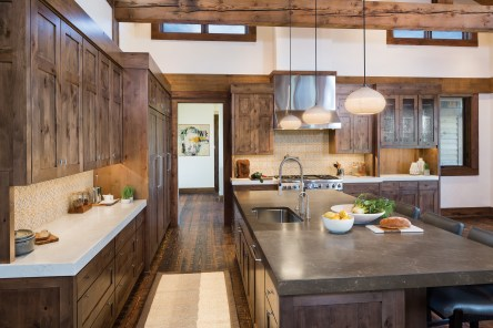 """The great room opens into the kitchen. """"We wanted a contemporary design to suit our tastes,"""" Wendy Gordon said, """"but rustic enough to make every space have an earthy warmth and encourage relaxation."""""""