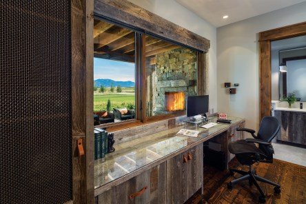 The private office looks out past the covered porch toward the Black Bull golf course.